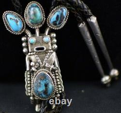 Early 70s Navajo Wrought Silver and Turquoise Yei Kachina Bolo Tie by Helen Long